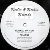 12 / TOURIST / HOOKED ON YOU