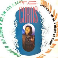 12 / T.C. CURTIS / LOVE'S GOT ME ON A MERRY GO AROUND / REUNITED